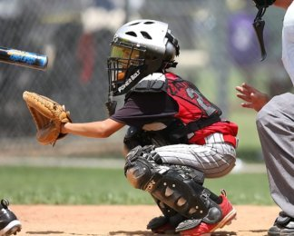 Youth Catcher in position, wearing knee savers