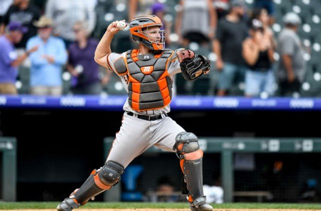 Buster Posey wearing Marucci catcher's gear, catcher throwing