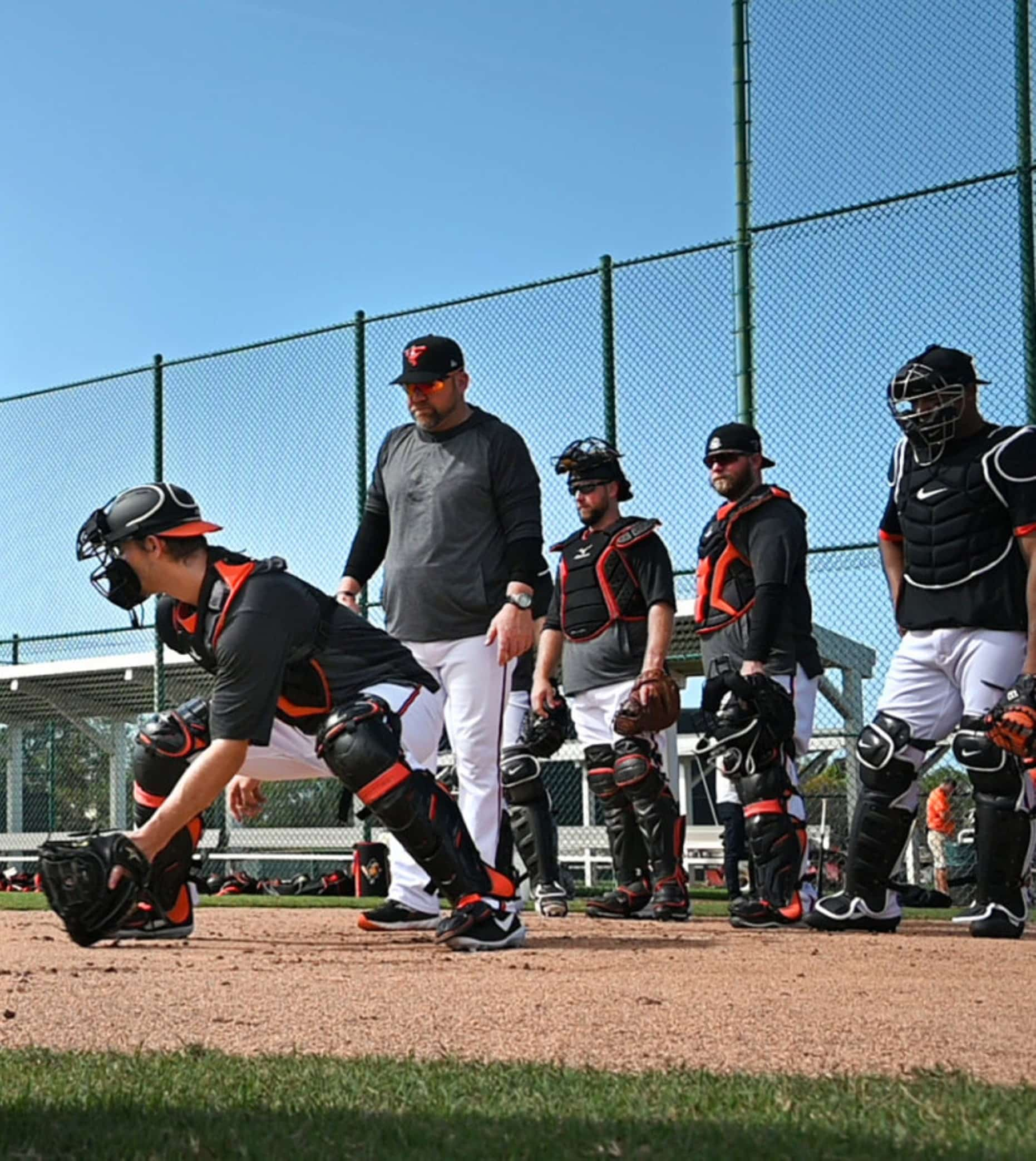 Baltimore Orioles catchers warming up during 2021 spring training