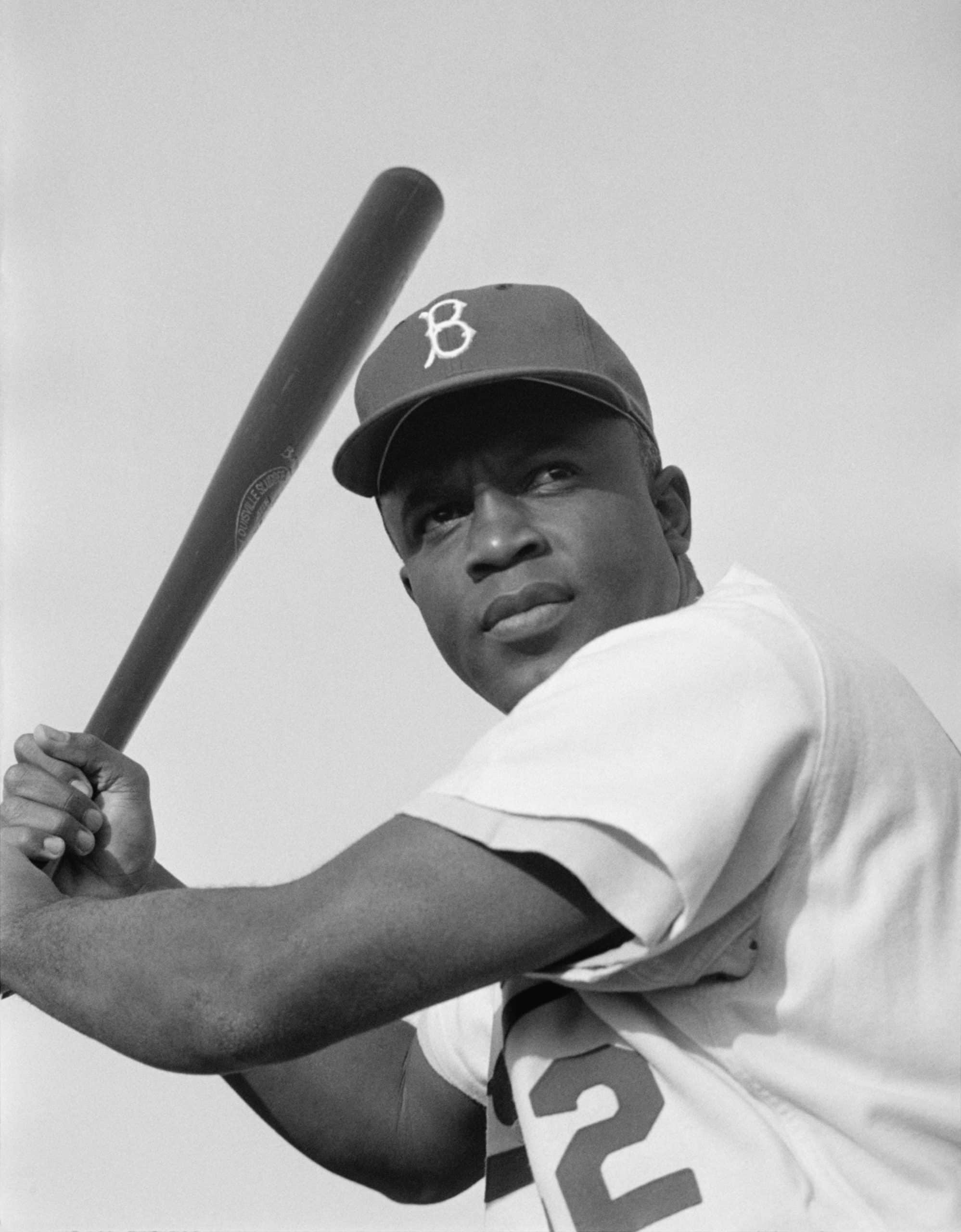 Jackie Robinson posing with a bat for a portrait