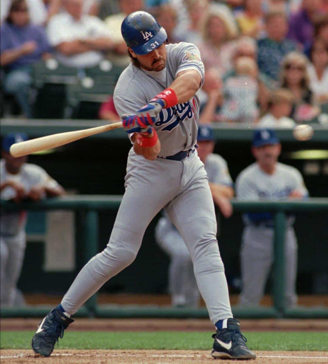 Mike Piazza hitting during a 1996 game against the Colorado Rockies