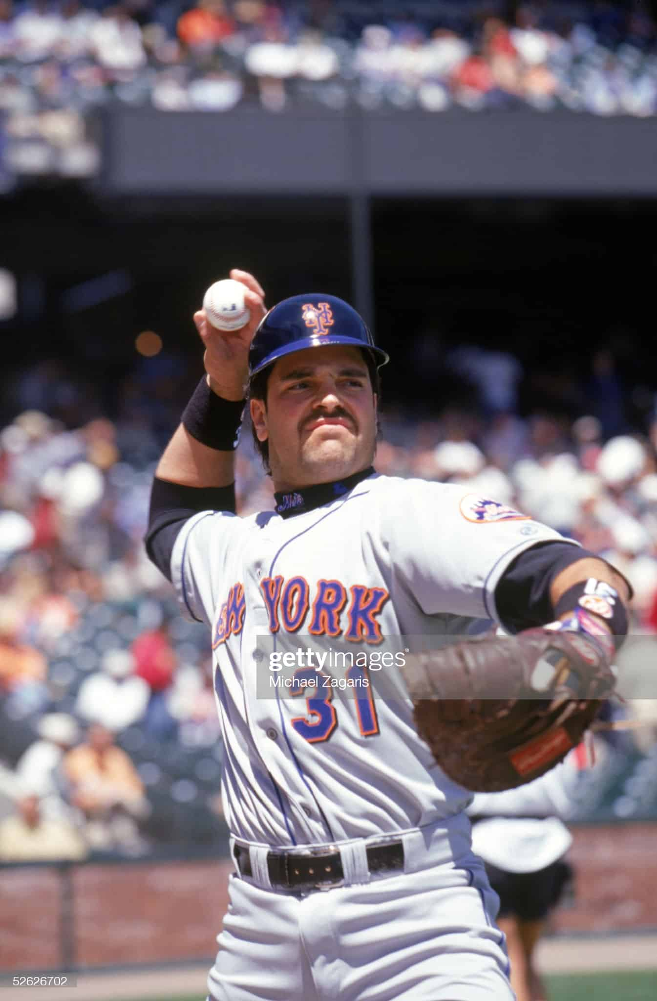 Former New York Mets catcher Mike Piazza warming up before a game against the Giants in San Francisco