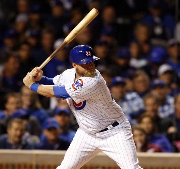 Chicago Cubs batter hitting during a night game at Wrigley Field