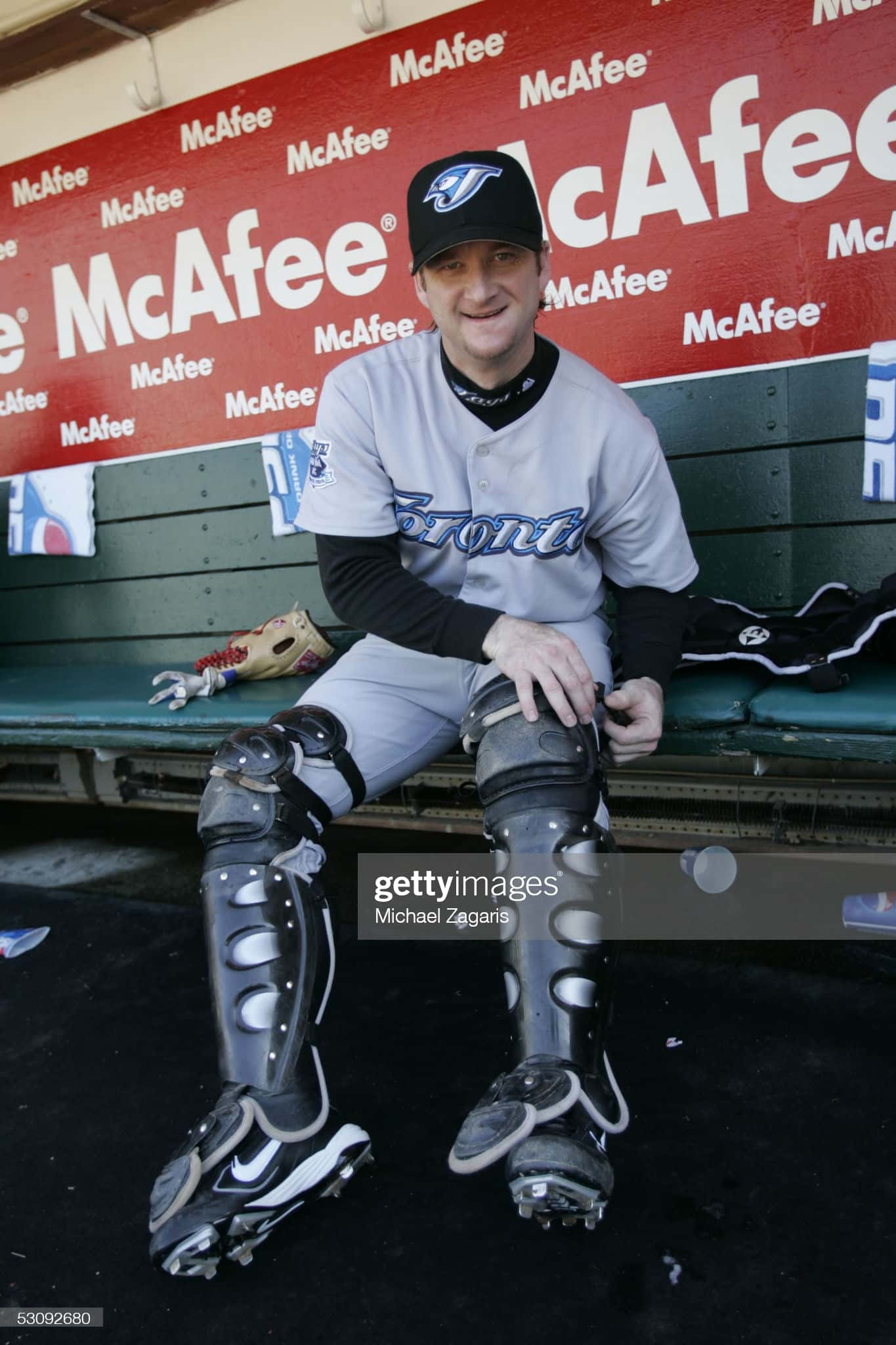 Gregg Zaun blue jays catcher putting on his catchers gear before a game in 2005