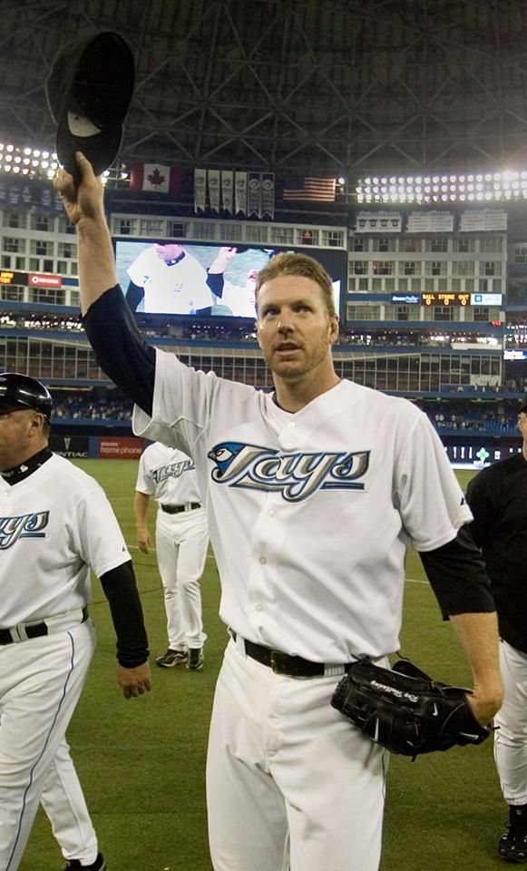 Former Toronto Blue Jays pitcher Roy Halladay waving to the crowd